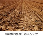 Sand on a brown agriculture acre - stock photo