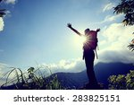 cheering woman hiker open arms... | Shutterstock . vector #283825151