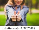 young teenage girl giving thumb ...