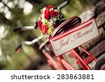 just married   bike and flowers | Shutterstock . vector #283863881