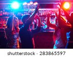 Stock photo energetic friends dancing in night club 283865597