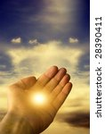 hand with mystical divine light like a symbol of hope - stock photo