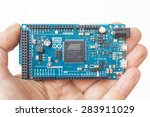 Small photo of LJUBLJANA, SLOVENIA - FEBRUARY 20, 2015: Photo of Arduino Due micro controller board in the hand. It is the first Arduino board based on a 32-bit ARM core micro-controller.