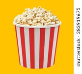 popcorn in red striped bucket... | Shutterstock . vector #283919675