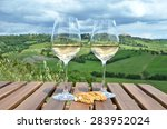 white wine and cantuccini on... | Shutterstock . vector #283952024