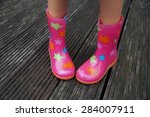 Stock photo child legs in rubber boots gumboots autumn shy kid in rainboots 284007911