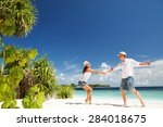 happy couple on the tropical... | Shutterstock . vector #284018675