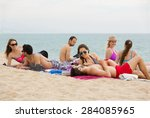 group of happy people laying on ... | Shutterstock . vector #284085965