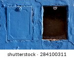 Two Metal Box And A Blue Wall...