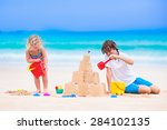 Kids Playing On A Beach. Two...