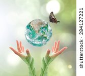 Green Planet With Butterfly...