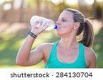 fit female athlete drinking... | Shutterstock . vector #284130704