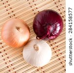 three large onions of different ...