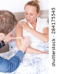 Small photo of Man putting adhesive bandage on arm of woman