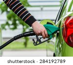 man fills up his car with a... | Shutterstock . vector #284192789