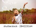 child with soap bubbles | Shutterstock . vector #284223164