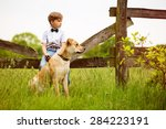 child with his dog | Shutterstock . vector #284223191