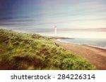 fisherman in a coastal landscape | Shutterstock . vector #284226314