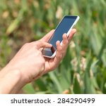 typing on smart phone | Shutterstock . vector #284290499