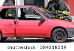 firefighter cuts the windshield ... | Shutterstock . vector #284318219