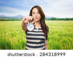 Woman Holding A Clock. Over...