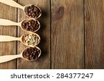 coffee beans in spoons on... | Shutterstock . vector #284377247