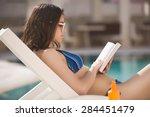 sexy brunette woman in bikini...   Shutterstock . vector #284451479