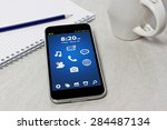 workplace with mobile phone on... | Shutterstock . vector #284487134