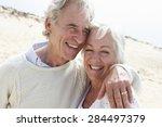 senior couple walking along... | Shutterstock . vector #284497379