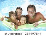 family on holiday in swimming... | Shutterstock . vector #284497844