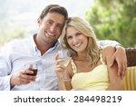 couple sitting on outdoor seat... | Shutterstock . vector #284498219