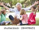 grandfather teaching... | Shutterstock . vector #284498651