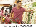 man pushing trolley by produce... | Shutterstock . vector #284500067
