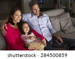 hispanic girl sitting on sofa... | Shutterstock . vector #284500859