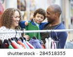 family looking at clothes on