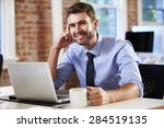 man working at laptop in... | Shutterstock . vector #284519135
