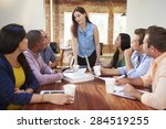 female boss addressing office... | Shutterstock . vector #284519255