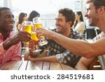 three male friends enjoying... | Shutterstock . vector #284519681