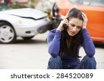 Small photo of Female Driver Making Phone Call After Traffic Accident