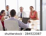 five businesspeople having... | Shutterstock . vector #284522087