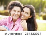 mother with adult daughter in... | Shutterstock . vector #284523017