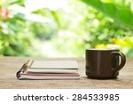 notebook  and coffee in brown... | Shutterstock . vector #284533985