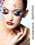 model with ornament on her head | Shutterstock . vector #28455343