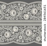 white lace ribbon. vertical... | Shutterstock .eps vector #284561651