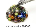 Photo Of Marbles In A Net Bag.