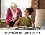 two women working at computer... | Shutterstock . vector #284569745