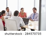 five businesspeople having... | Shutterstock . vector #284570735