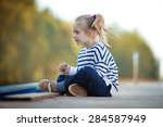 a cute little girl in a striped ... | Shutterstock . vector #284587949