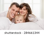 a young family with little... | Shutterstock . vector #284661344