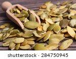 heap of pumpkin seeds with... | Shutterstock . vector #284750945